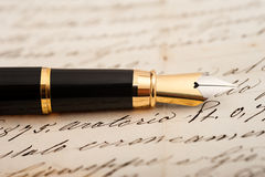 Fountain pen on letter Royalty Free Stock Image