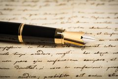 Fountain pen with heart Royalty Free Stock Image