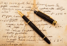 Fountain pen on letter. Fountain pen with cap on an antique  letter Stock Photography