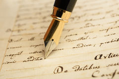 Fountain pen on a letter. Fountain pen is writing on a letter Stock Photography