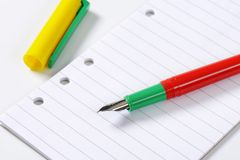 Fountain pen on lined paper Stock Photo