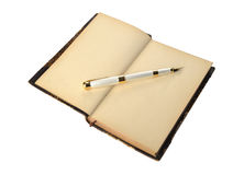 Fountain pen lying on old open book page Royalty Free Stock Image