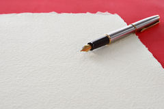 Fountain pen lying on page Royalty Free Stock Photo