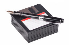 Fountain pen lying on a pile of floppy disks Stock Images