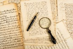Fountain pen and magnifying glass royalty free stock photo
