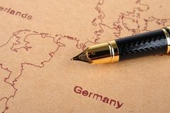 Fountain pen and map Stock Photo