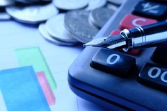 Fountain pen and Money coins stack and calculator for finance concept Stock Photos