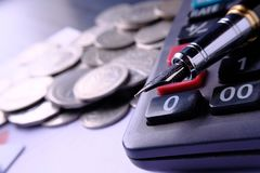 Fountain pen and Money coins stack and calculator for finance concept Stock Photo