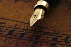 Fountain pen on music sheet Stock Photo