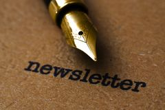 Fountain pen on newsletter  text Royalty Free Stock Photos