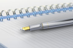 Fountain pen on notebook Stock Images
