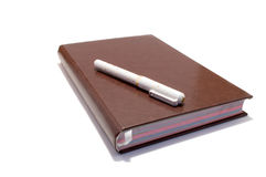 Fountain pen on the notebook Stock Image