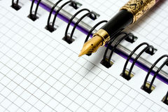 Fountain Pen on notebook Stock Photo
