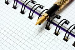 Fountain Pen on notebook Stock Photo