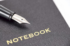 Fountain pen and notebook Stock Images