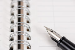 Fountain pen and notebook Royalty Free Stock Photo