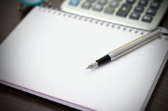 Fountain pen on notebook Stock Photography