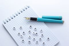 Fountain pen and notebook with letters on white background, close-up royalty free stock photo