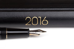 Fountain pen and notebook 2016 Royalty Free Stock Photo