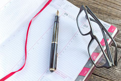 Fountain pen and notebook planner Royalty Free Stock Photography