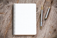 Fountain pen and notebook with square grid Stock Image