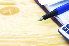 Fountain pen and notebook on the table Royalty Free Stock Image
