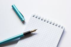 Fountain pen and notebook on white background, close-up royalty free stock images