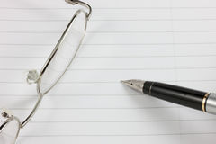 Fountain Pen,Notepad & Glasses Royalty Free Stock Image