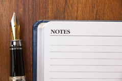 Fountain pen and notes Royalty Free Stock Photo