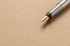 Fountain pen on old paper royalty free stock photography