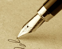 Fountain pen on a old paper. Vintage image Stock Image