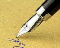 Fountain pen on a old paper. Vintage image Royalty Free Stock Photo