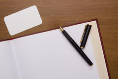 Fountain pen on an open book Royalty Free Stock Photography