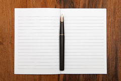 Fountain pen on an opened notepad Stock Photos