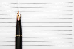 Fountain pen on an opened notepad Stock Image