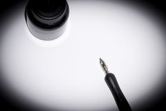 The fountain pen on paper on black Royalty Free Stock Photos