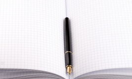 Fountain pen on paper notebook Royalty Free Stock Images
