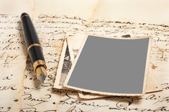 Fountain pen and pictures. On old letters Stock Photos