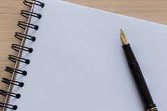 Fountain Pen Placed on a Blank Notebook Royalty Free Stock Photography