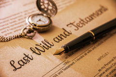 Fountain pen, a pocket watch on a last will and testament. stock photo