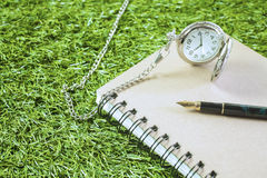 Fountain pen and pocketwatch Royalty Free Stock Photography