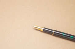 Fountain pen and pocketwatch Stock Images