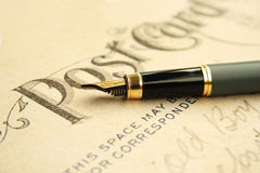 Fountain pen on post card Royalty Free Stock Images