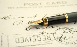 Fountain pen on post card Royalty Free Stock Image