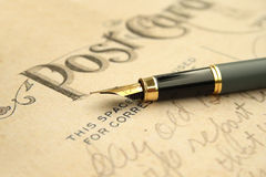 Fountain pen on post card Stock Photography