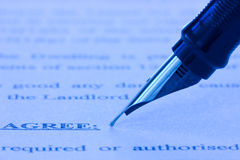 Fountain pen and printed agreement. Close-up of fountain pen and printed agreement Stock Images