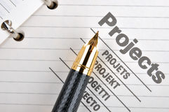 Fountain pen on project. Project book page or document and a fountain pen, shown as project woking and other business concept Stock Image