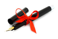 Fountain pen with red bow Royalty Free Stock Photo