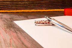 Fountain pen on a red tree stock photography