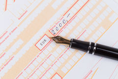 Fountain Pen on Remittance slip Royalty Free Stock Image